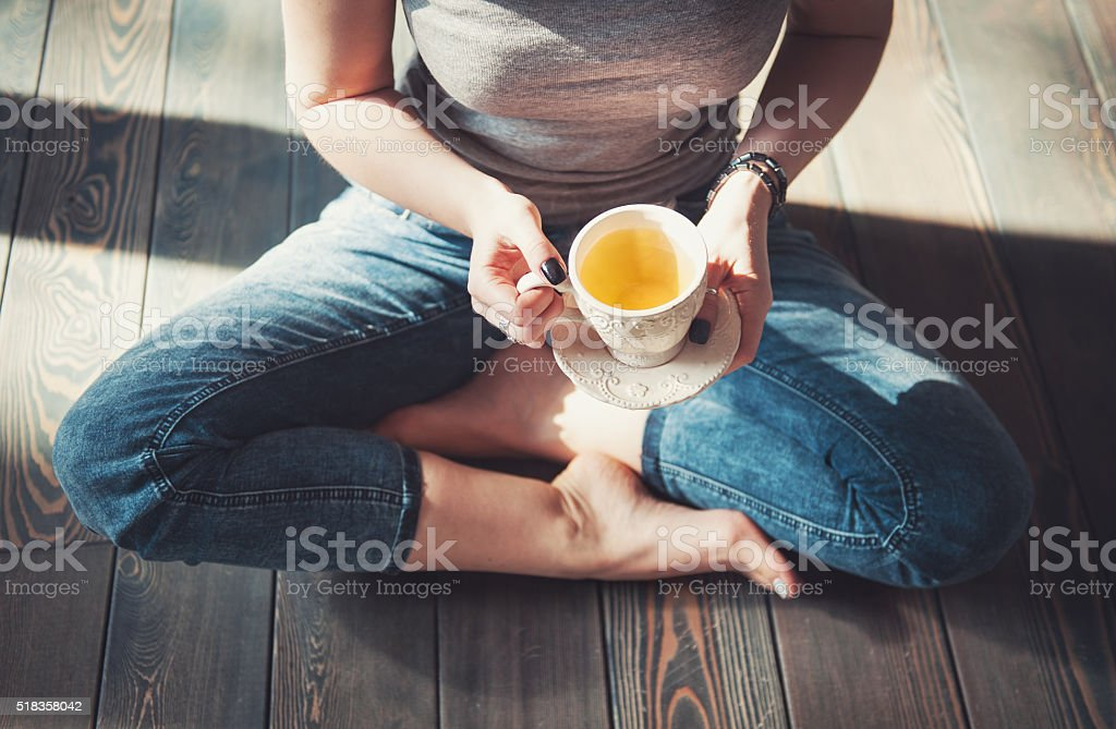 Cozy photo of young woman with tea stock photo