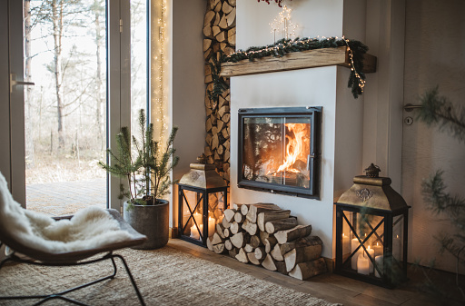 Cozy living room winter interior with fireplace.