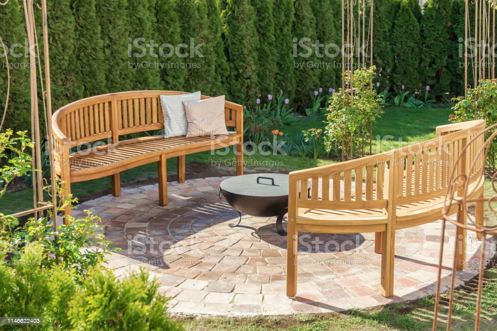 Picture of: Cozy Place In The Garden To Read Relax And For Cozy Evenings By The Fire Bowl Stock Photo Download Image Now Istock