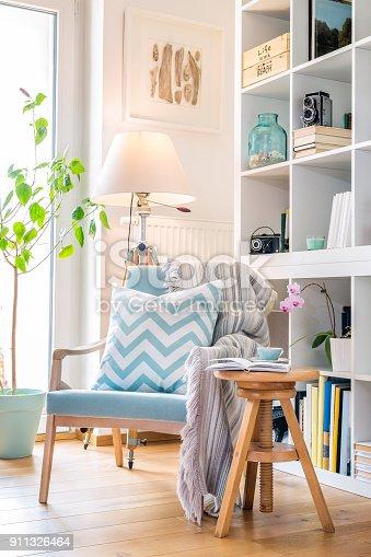 istock Cozy reading corner with armchair. 911326464