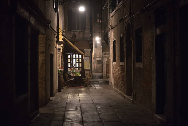 Cozy restaurant in an alley at night in Venice Cozy restaurant in an alley at night in Venice, Italy alley stock pictures, royalty-free photos & images