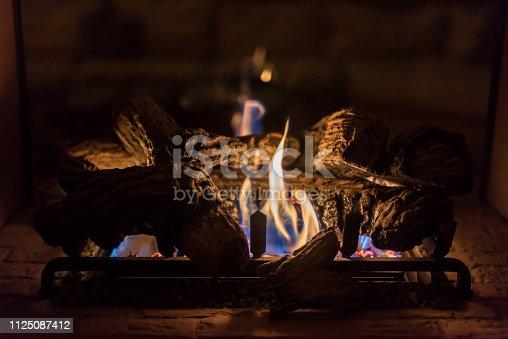Closeup of gas log fireplace on romantic evening