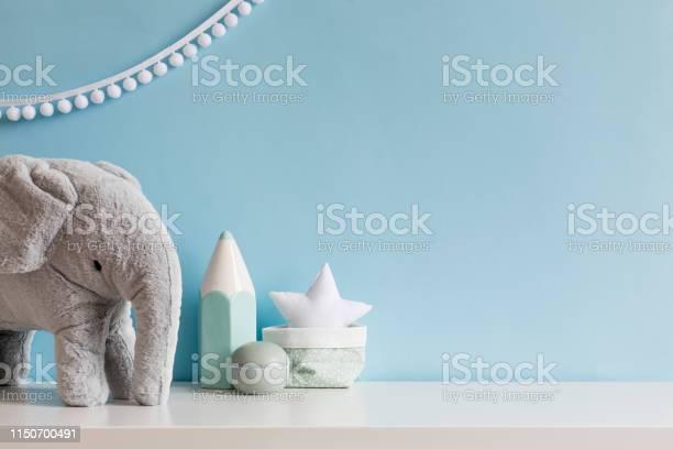 Cozy scandinavian newborn baby room with gray plush elephant white picture id1150700491?b=1&k=6&m=1150700491&s=612x612&h=nkgmw2meok9cemm e4bboa7zn2w tghx la1cxgr5y0=