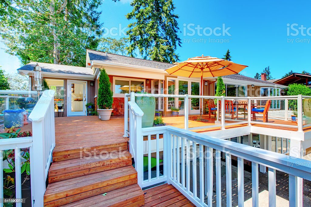 Cozy screened walkout deck with patio area stock photo