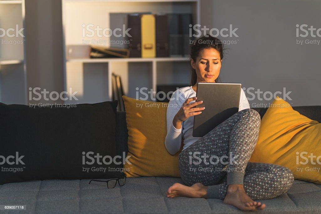 Cozy sofa and work stock photo