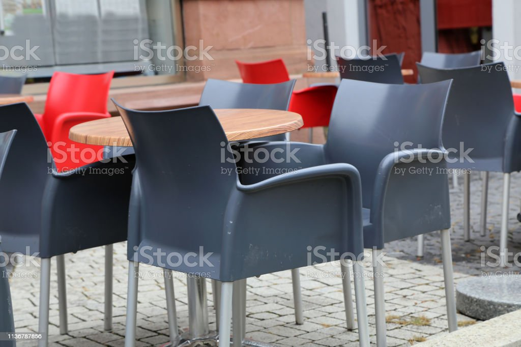Cozy street restaurant, Tables and chairs in the street.