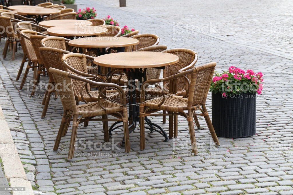 Cozy street restaurant. Tables and chairs in the streets
