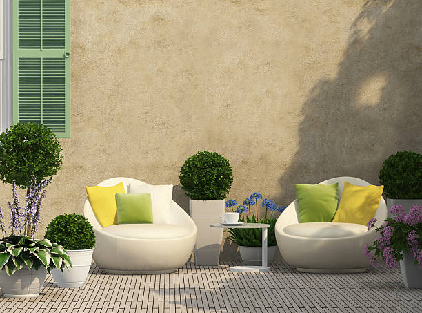 Cozy terrace in the garden Cozy terrace in the garden with flowers courtyard stock pictures, royalty-free photos & images