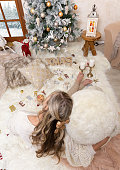 Cozy Christmas joy and peace on a fluffy rug in front of the Christmas tree