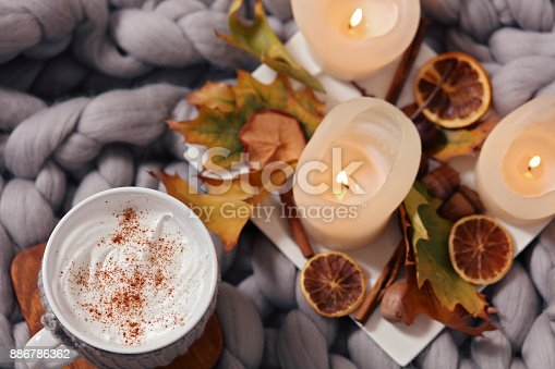 istock Cozy winter evening , cup of coffee, soft blanket, candles. Comfy lifestyle. 886786362