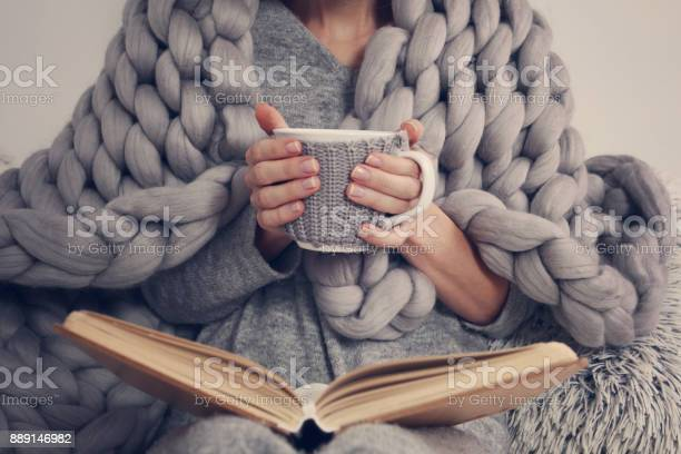 Cozy woman covered with warm soft merino wool blanket reading a book picture id889146982?b=1&k=6&m=889146982&s=612x612&h=ilczuvsg1patrqqnxd69jckol39q2l2btvwisrz0fli=