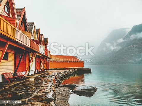 istock Cozy wooden country houses terrace exterior mountains and fjord view in Norway scandinavian style 1047136840