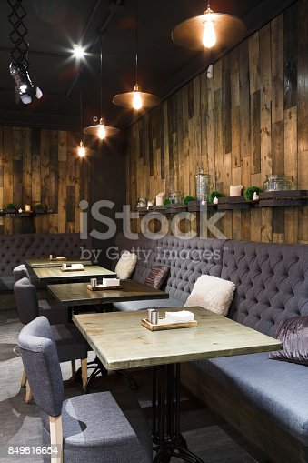 istock Cozy wooden interior of restaurant, copy space 849816654