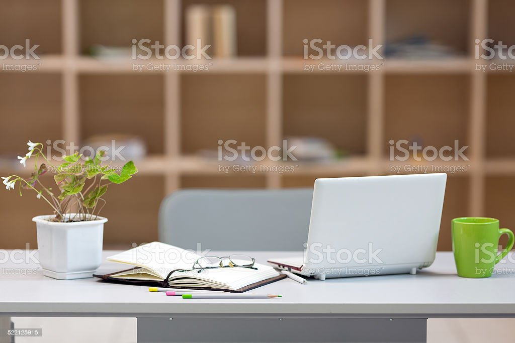Cozy working Place on Wood Wall background stock photo