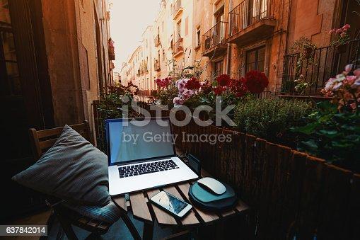 istock Cozy workspace on balcony in Barcelona 637842014