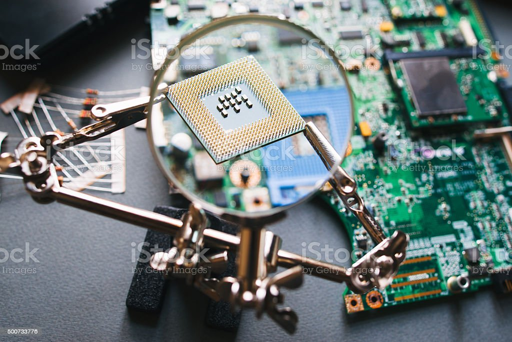 Cpu processor through a magnifying glass. stock photo