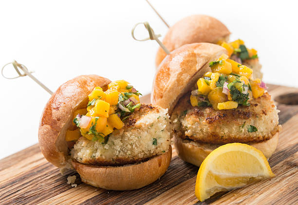 Crab Cake Sliders Crab Cake Sliders in white background slider burger stock pictures, royalty-free photos & images