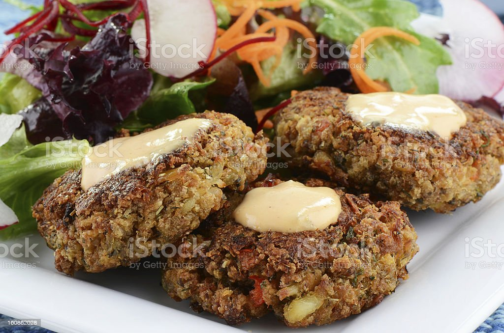 Crab cakes with salad royalty-free stock photo