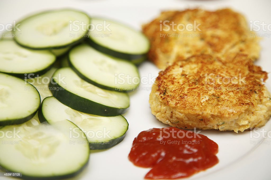 Crab Cakes with Sliced Cucumbers and Cocktail Sauce royalty-free stock photo