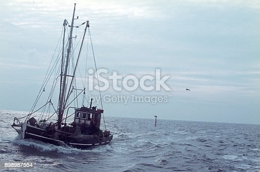 St. Peter Ording, Sylt, Schleswig Holstein, Germany, 1974. Crab cutter in front of the island of Sylt.