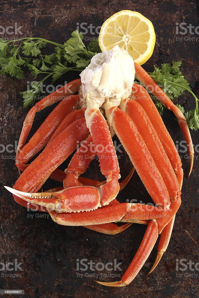 Crab legs on brown background stock photo