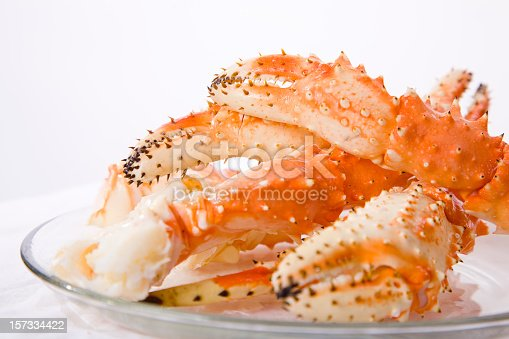 A pile of fresh crab legs on a white background.