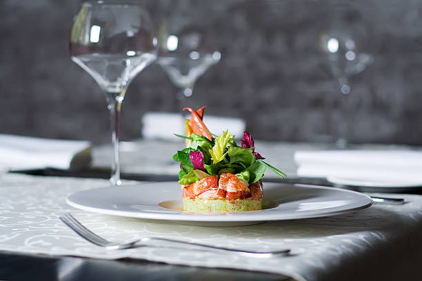 Crab meat appetizer, seafood delicacy in restaurant interior stock photo