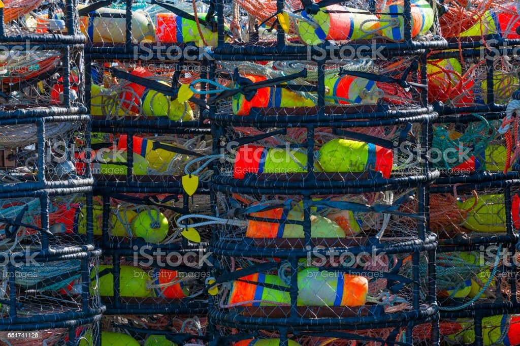 Crab pots stacked on pier stock photo