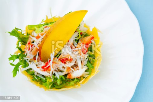 crab salad with mango in cheese basket