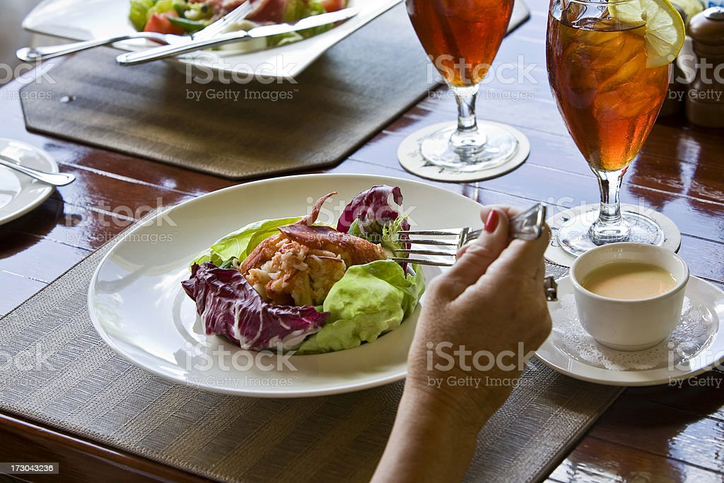 Crab Salad With Iced Tea in Casual Setting stock photo