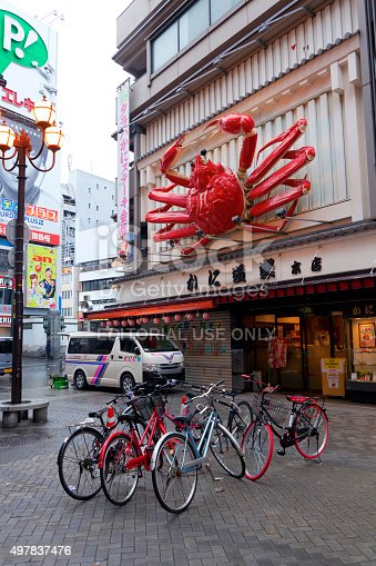 Osaka,Japan - April 20,2015 : Huge red crab sculpture in front of the restaurant in Namba shopping street taken on April 20,2015 in Osaka,Japan. The crab sculpture is very famous among tourists which is becoming one of the symbol of Namba area in Osaka.
