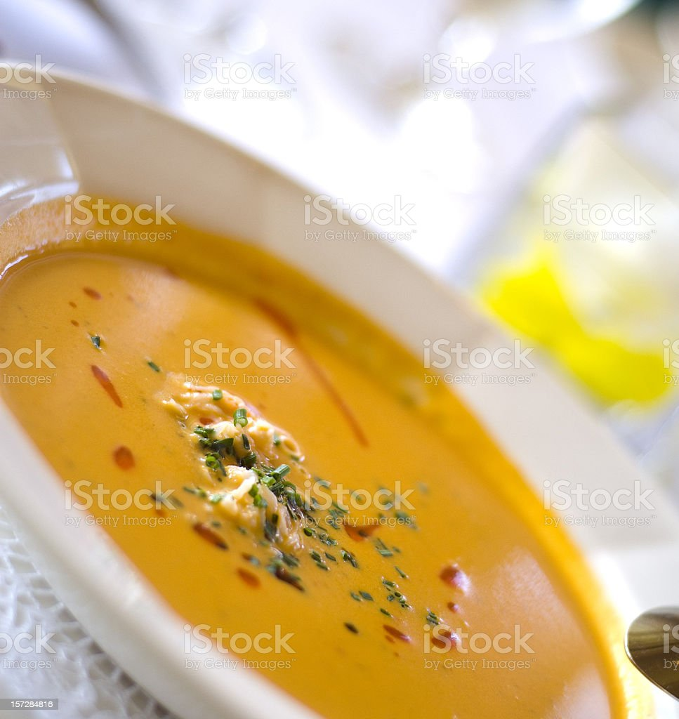 Crab Seafood Atop Pepper & Tomato Bisque Vegetable Soup Bowl stock photo