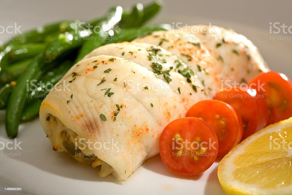 Crab Stuffed Flounder and Tomatoes stock photo