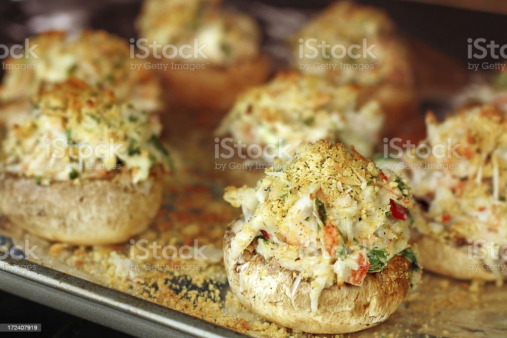 Crab Stuffed Mushrooms Baking in the Oven stock photo