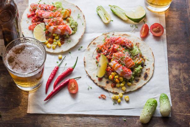 Crab tacos with guacamole, corn and salsa, flat lay stock photo
