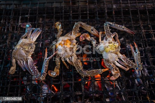 Close up shot of grilling flower crab on a barbecue.