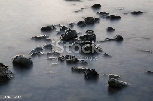 Long exposure stones and crabs
