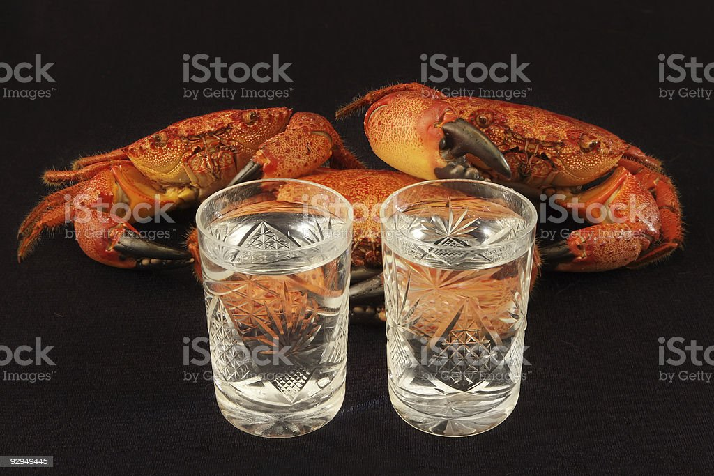 Crabs with vodka. royalty-free stock photo