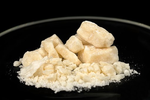 Crack, a type of drug obtained through chemical processes from cocaine. Amazing substance in small pieces. Crack is produced by dissolving powdered cocaine in a mixture of water and ammonia or sodium bicarbonate (baking soda). The mixture is boiled until a solid substance forms. The solid is removed from the liquid, dried, and then broken into the chunks (rocks) that are sold as crack cocaine. The name