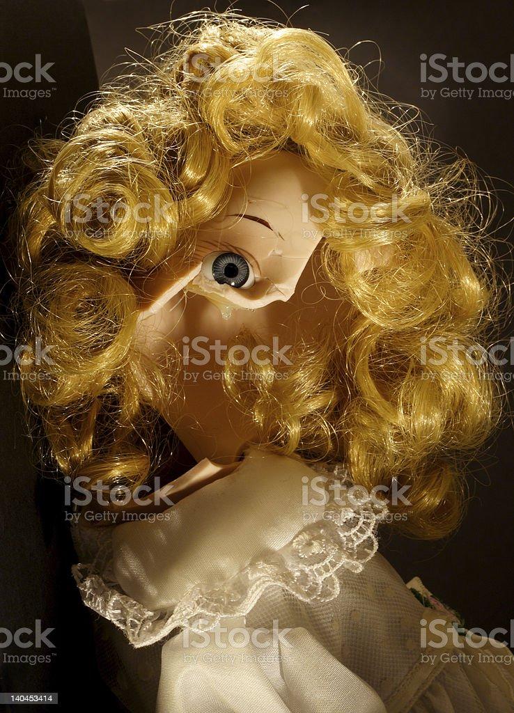 crack doll sitting royalty-free stock photo