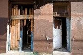 istock Crack House Doors 173624958