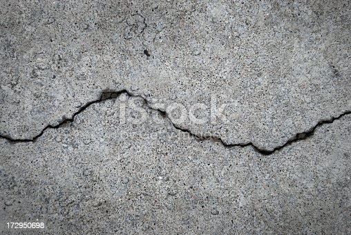 istock Crack in grey concrete surface 172950698