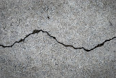 Crack in grey concrete surface