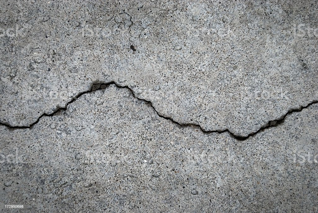Crack in grey concrete surface stock photo