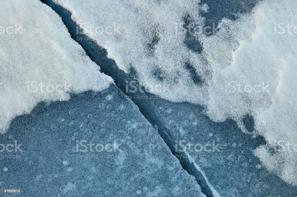 Crack in Ice and Snow on a Frozen Minnesota Lake royalty-free stock photo