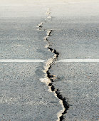 Long crack stretching cross the street.The origin is the Santiago/Chile earthquake 2010.