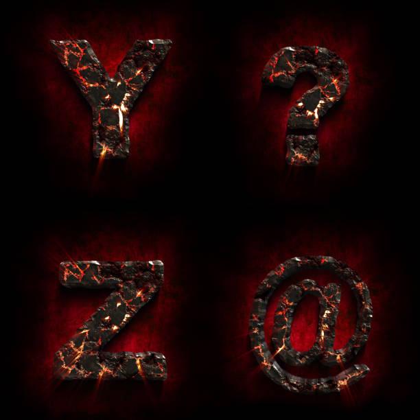 Crack lava stone alphabet. Volcanic letter. Halloween concept. stock photo