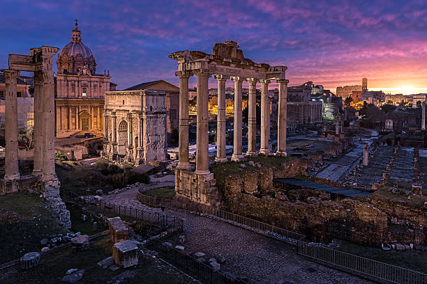 Crack of dawn Today i had the opportunity to shoot the ancient part of Rome, known as the Roman Forum. i had a walk around the city since it took me a while to get there, through the early morning and i was almost hopeless about the sky, but yet when i approached the old city some colors begun to pop in the clouds. I rushed a little to arrive to the location i intended to shoot and started to look for the perfect angle, the colors in the sky were just amazing. and i was super excited to have the opportunity to at least see this natural phenomenon and even more capture that with my camera. It was simply stunning ..I did 3 shots for this one (bracketed -1,0,+1) and than blended basically the 0 and +1 exposure since thats all i needed to achieve the perfect balance of light, the shot was fantastic from camera and very minor changes have been done in post processing, like some color correction in the foreground and also removing the tint from the sky reflection on the pavement..Hope you enjoy ancient rome stock pictures, royalty-free photos & images