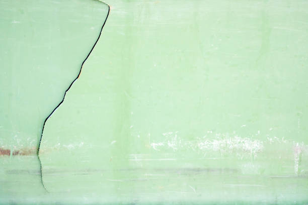 Crack on hard plastic surface. stock photo