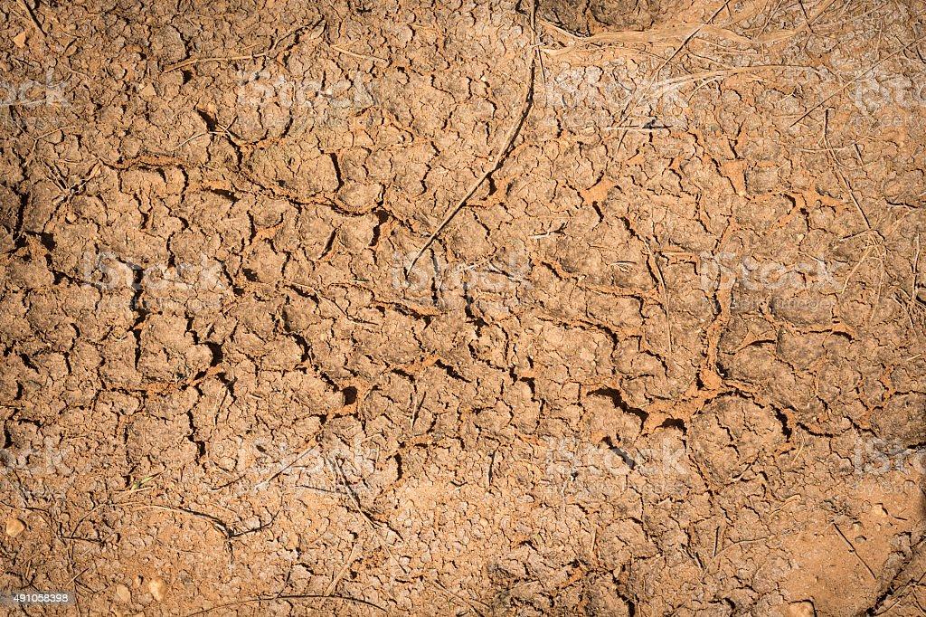 Crack soil dry season on sand background. stock photo